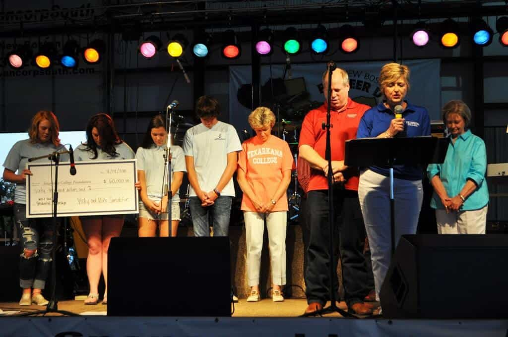 Donor Vicky Sandefur, also a Methodist pastor, offers a blessing on stage during the check presentation.