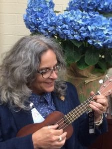 Dr. Catherine Howard playing a ukulele
