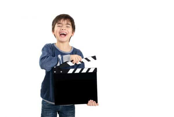 boy with clapboard