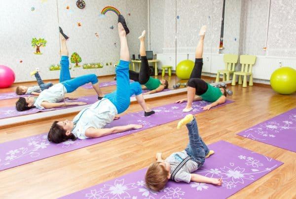 kids stretching on yoga mats