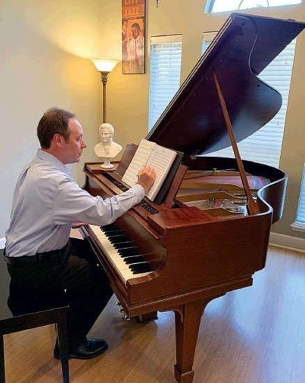 Marc-Andre Bougie composing at the piano