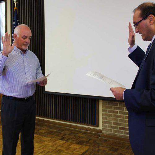 Dr. John Booth swearing in